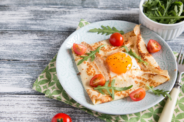 crepes with eggs cheese arugula leaves