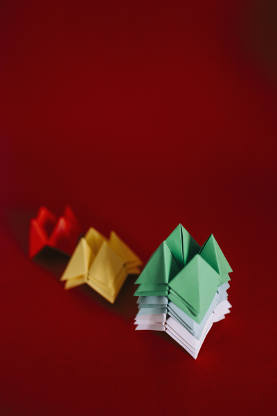 multicolored origami fortune tellers on red