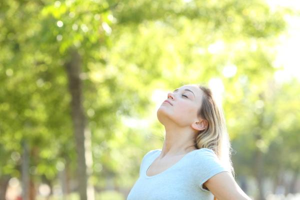 relaxed teenage girl breathing fresh air
