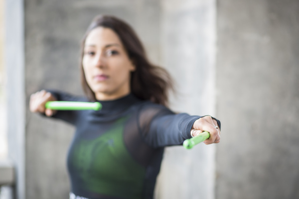 young woman doing pound fitness exercise