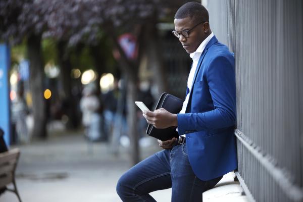 young businessman wearing blue suit jacket