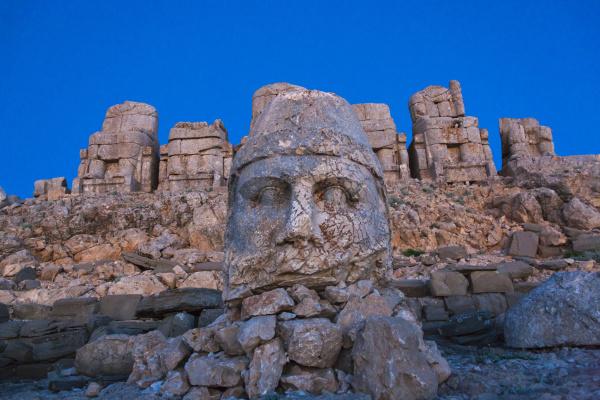 statue of head at sunrise on