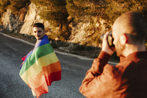 photographer taking picture of man wrapped