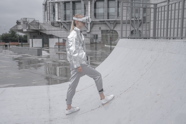 girl in silver suit looking through