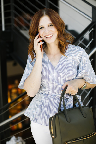 smiling mid adult woman on phone