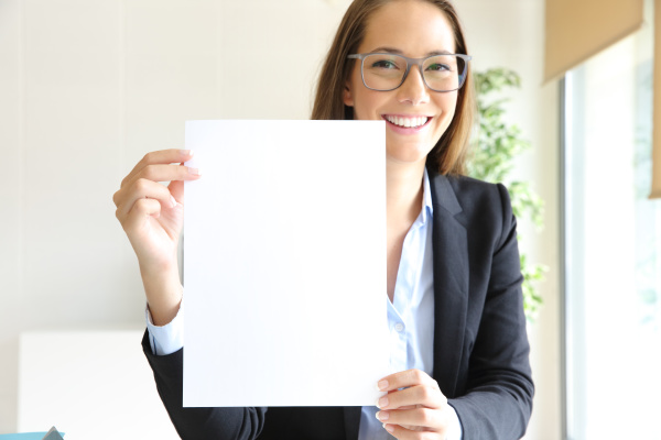 happy businesswoman showing blank contract at