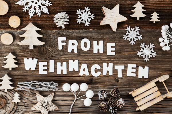 wooden decoration frohe weihnachten means