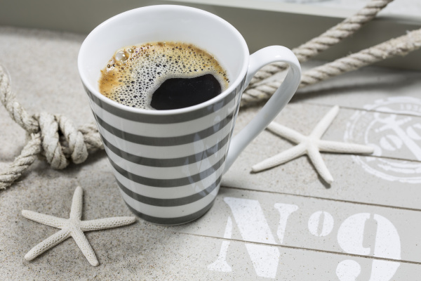 beach coffee in striped cup