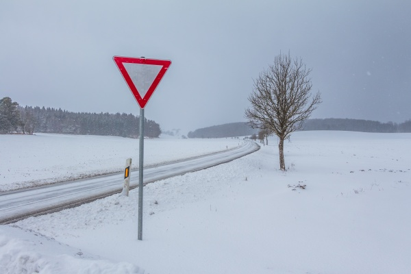white empty snowy icy winter road