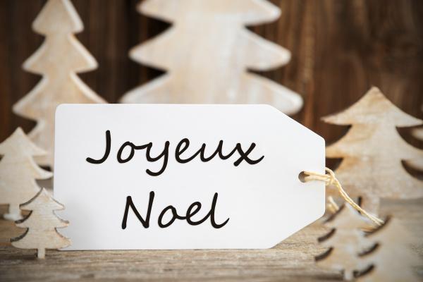 christmas tree label joyeux noel means