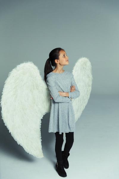 portrait confident curious girl wearing angel