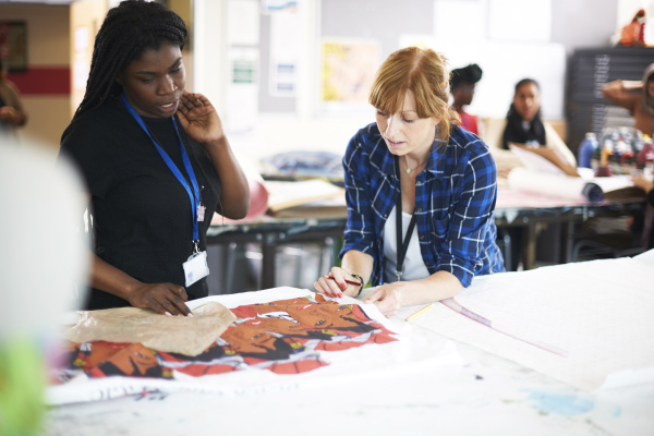 female artists looking at screen print