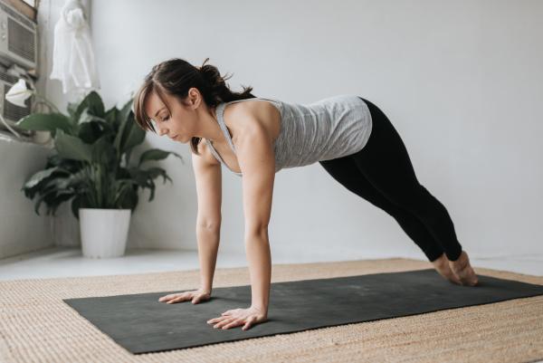 woman practising yoga in studio