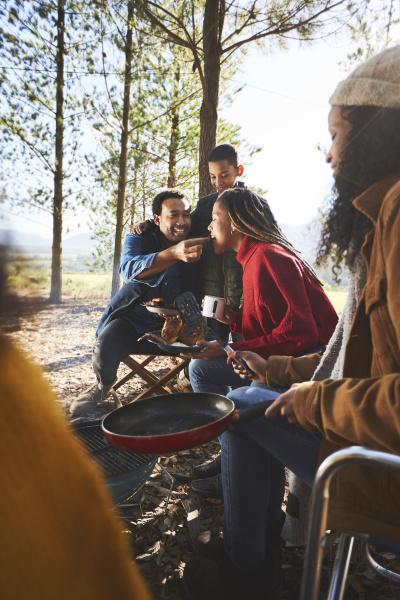 husband feeding wife at campsite