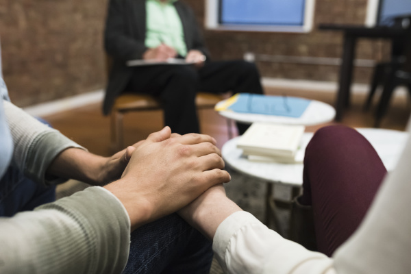 couple having therapy at psychiatrists office