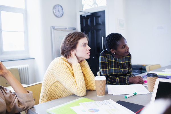 attentive businesswomen listening in conference room