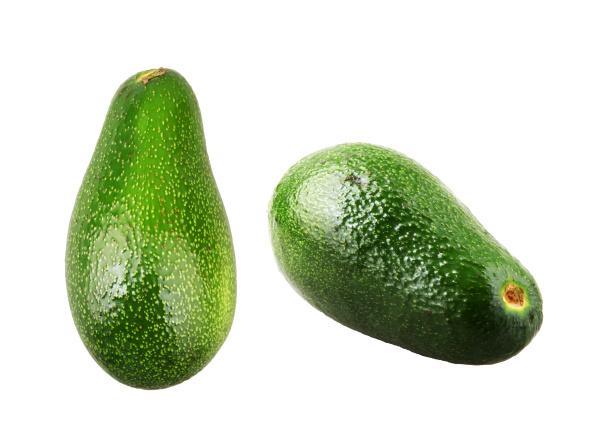 whole avocado isolated on white background
