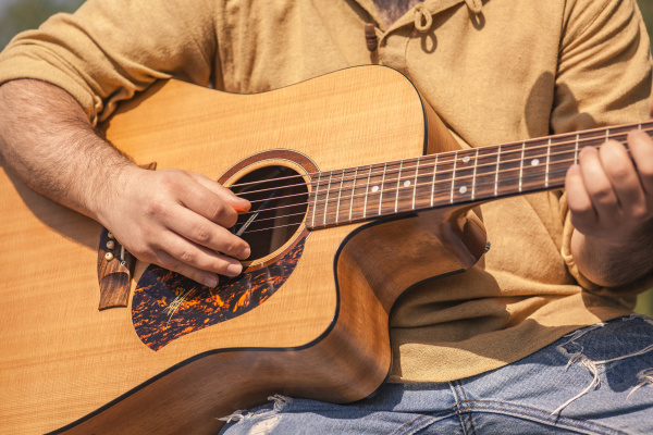 rocker musician plays classical guitar
