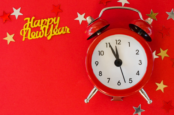 festive christmas background with alarm clock