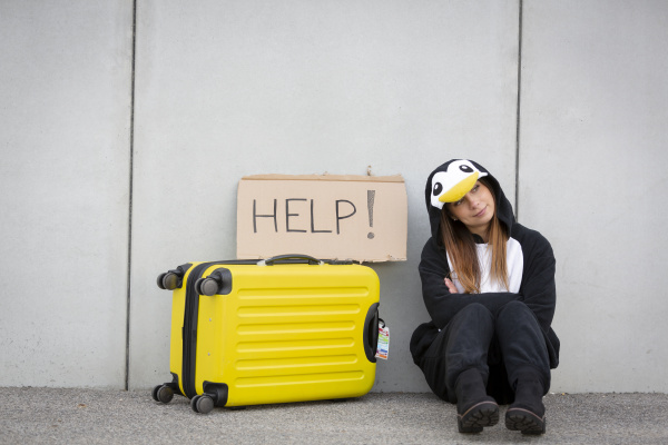 young woman with penguin costume and