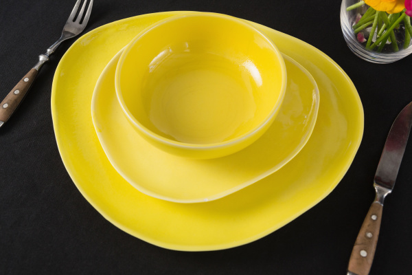 table setting with yellow bowl and
