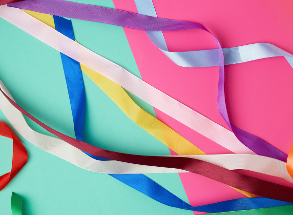 many silk multi colored ribbons on