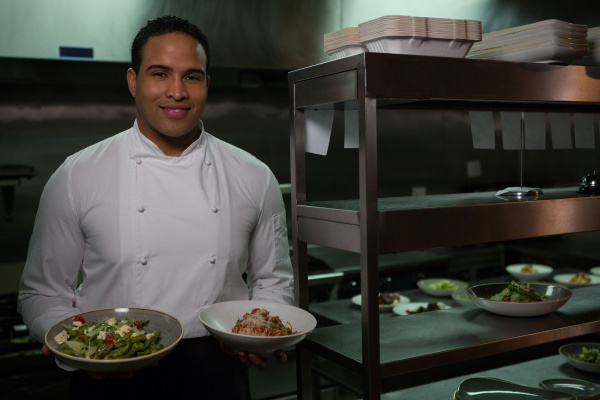 chef presenting his food plates