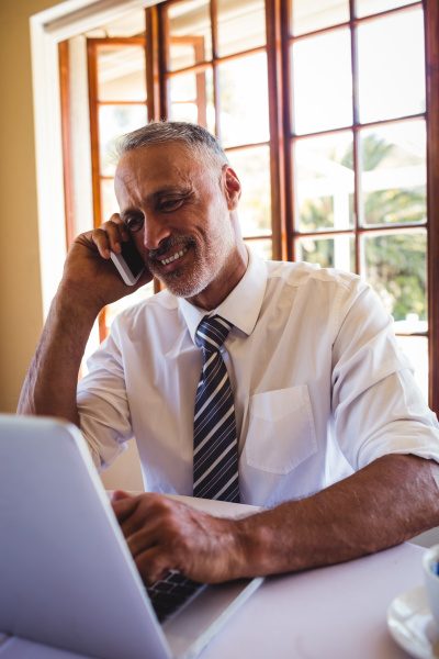 businessman talking on mobile phone while