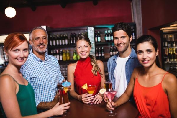 friends enjoying cocktail in nightclub