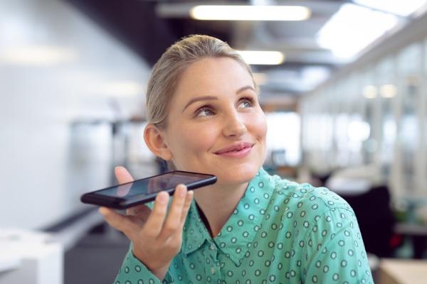 female graphic designer talking on mobile