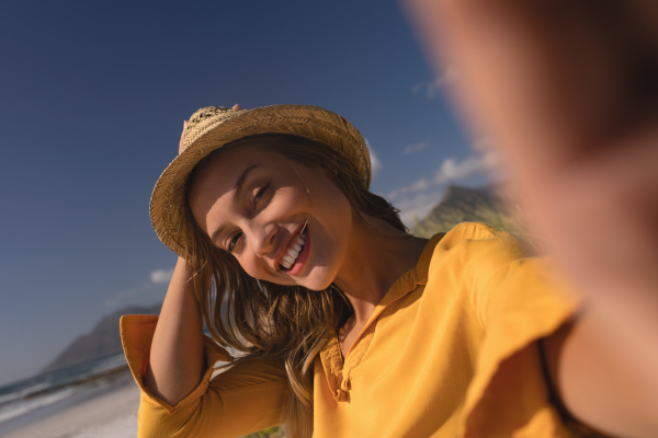 woman wearing hat relaxing on the
