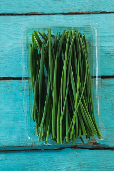 garlic chives in plastic container