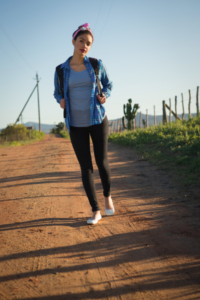 woman walking on dirt track in