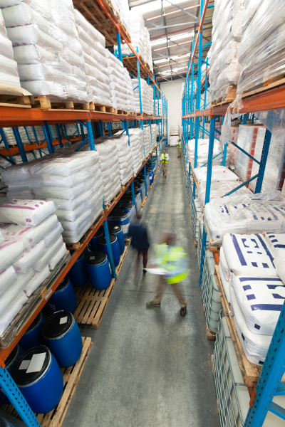 warehouse staff checking stocks in warehouse