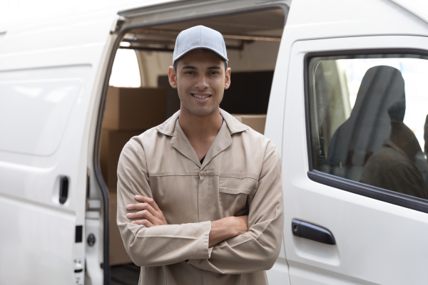 delivery man standing with arms crossed