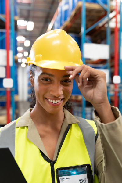 female staff with hardhat looking at