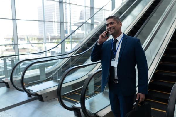 caucasian businessman talking on mobile phone