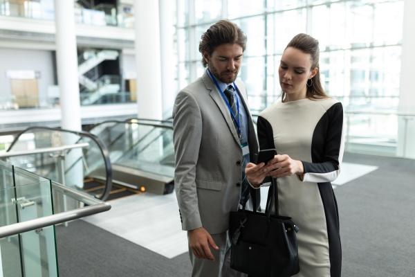 caucasian businessman and caucasian businesswoman discussing