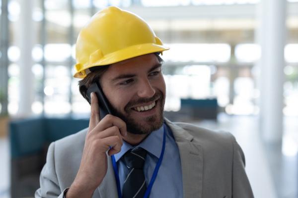 caucasian male architect talking on mobile
