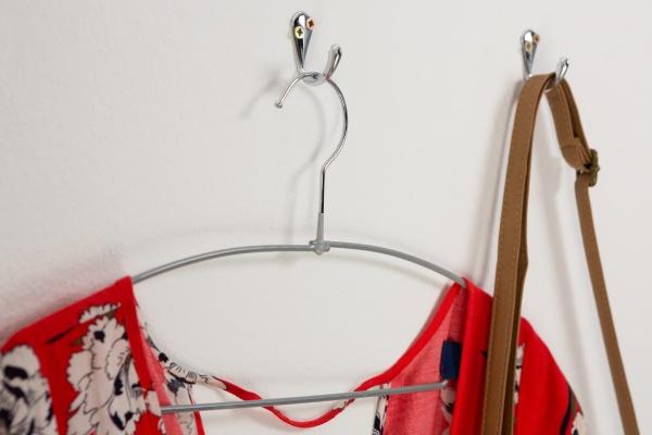 dress and bag hanging on hook