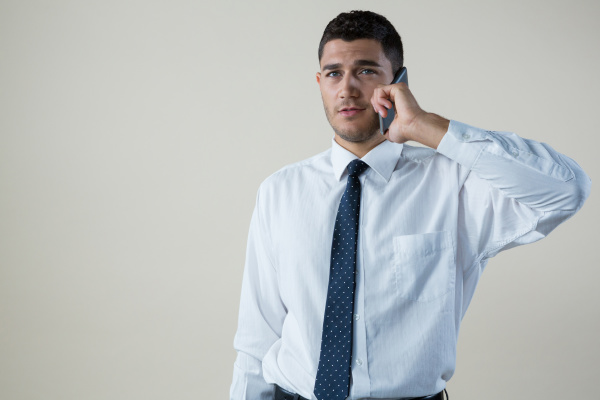 executive talking on mobile phone