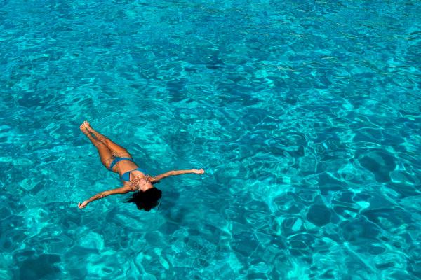 woman in bikini enjoying clear sea