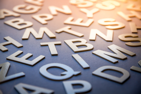 mixed letters pile closeup photo
