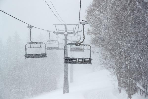 ski lift in falling snow