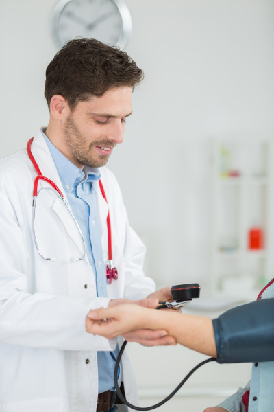 portrait of happy doctor checking patients