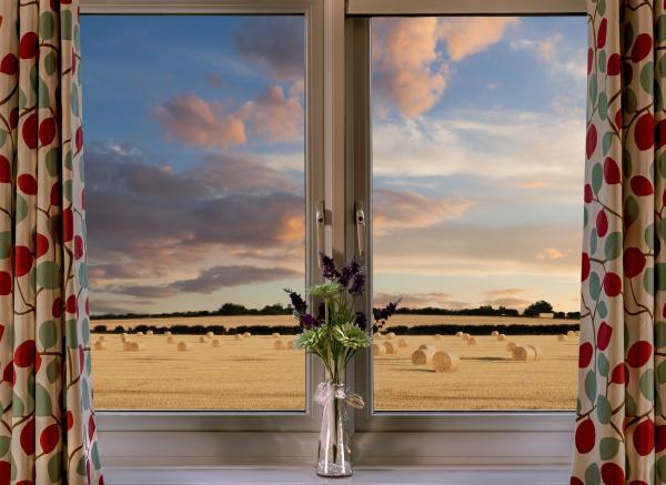window view onto fields of hay
