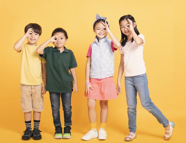 happy school children stanging together