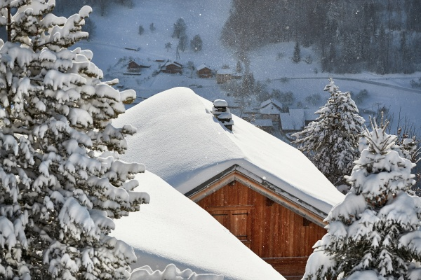 winter mountain village roof and chimney