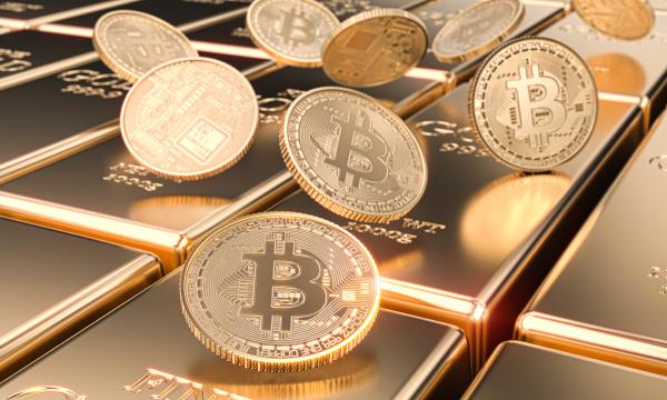 several bitcoin motes on gold bars