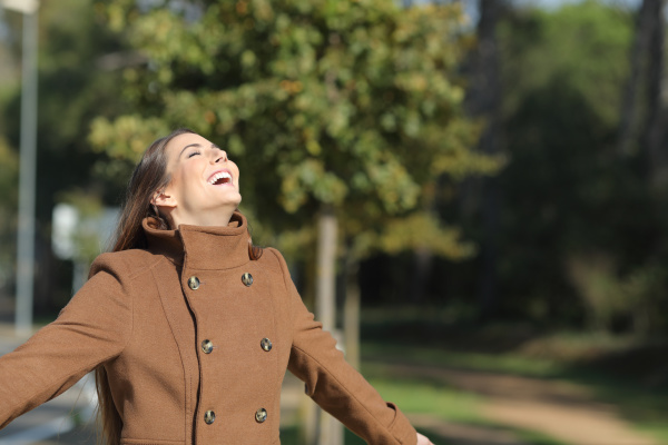 happy woman is breathing fresh air